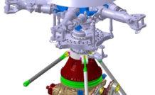 Une vue de la tête rotor (en haut) et de la boîte de transmission principale (en bas) du H225, avec les trois jambes concernées par l'inspection.