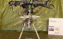 La tête rotor, le mât et les jambes de suspension arrière.